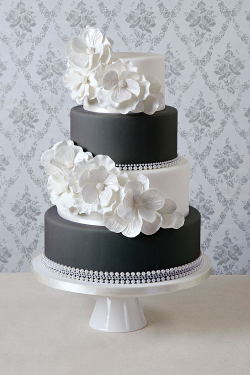 How to select your perfect wedding cake todaysbride a 3 tier black and white cake with fondant flowers mightylinksfo
