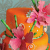 Orange cake with pink flowers