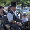 Coachman drives horse and carriage
