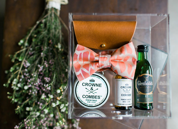 Groom's bowtie and mini scotch bottles