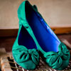 Emerald green ballerina flats with bow detail
