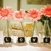 Small clear vases with black and white L-O-V-E lettering