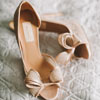 Nude open peep-toed sandals with lace bow details