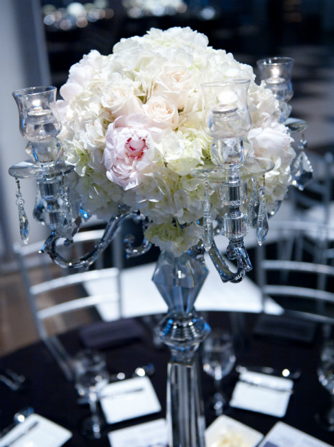Elegant silver-stemmed centrepiece with white and light pink roses and white peonies.