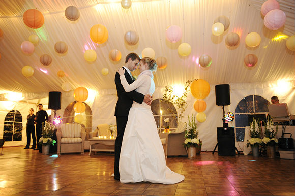 Hanging lanterns light the dance floor during the couple's first dance