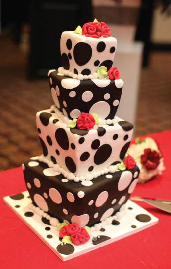 Whimsical black and white polka dot cake with fondant roses and pearl trim