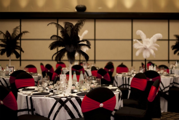 Red &amp; black chair covers, black &amp; white linens, feather centerpieces