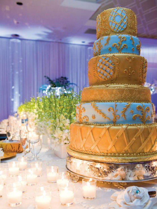 Vintage-inspired gold & blue six tier cake with intricate fondant & buttercream detail