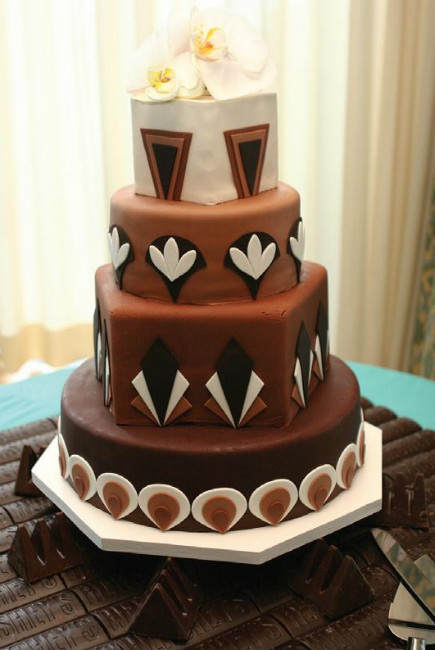 Cream, black & brown fondant three tier cake with fondant patterns & orchid topper