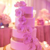 4 tier elegant ivory cake with gold ribbon and cascading fondant flowers