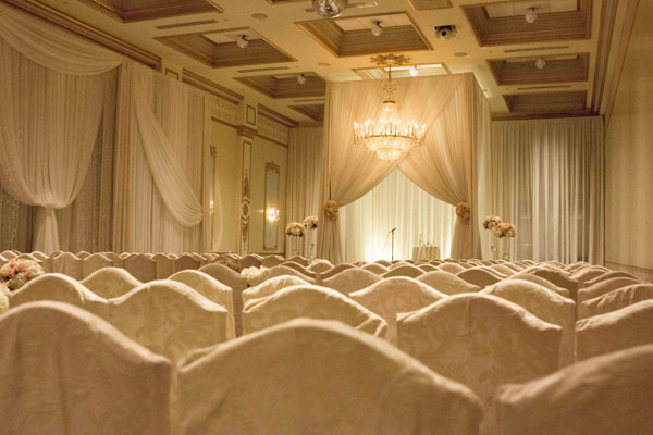 Ivory chair covers with matching ivory drape decor