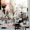 Twig centerpieces, wood chairs and high ceilings