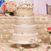 Four tier unique ivory cake with piped pearl detail and champagne coloured roses on top