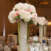 Tall vases filled with crystals and large white & pink floral bouquets