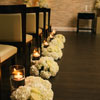 Aisle decor with candles and floral arrangements