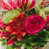 Whimsical bouquet with pink, orange and green floral accents.