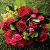 Vibrant red and hot pink bouquet with roses