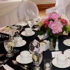 Black and white table d&#233;cor with pink and red floral accents