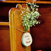"Small bouquet of baby's breath adorned with decorative tree trunk ""love note"" detail"