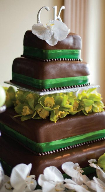 Brown fondant cake with green fondant trim and monogram initials topper