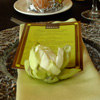 Green wedding d&#233;cor with gold accents on menu