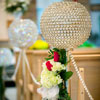 Ceremony aisle decor incorporating flowers and decorative stands