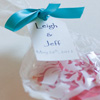 Heartshaped cookies in embellished favour bags with personalized tags