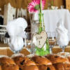 Rustic wedding theme with white table linens and pink flowers