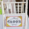 Rustic wedding theme with Bride and Groom-specific chairs