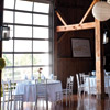 Rustic-themed with white linens, wood chairs and patio lanterns