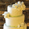 Quilted tier cake with green ribbon trim