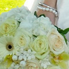 Springtime bouquet with white daisies, blush, yellow and white roses