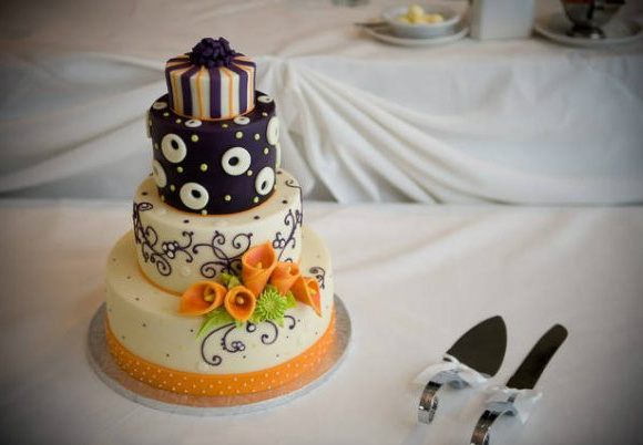 Whimsical four-tiered cake with orange calla lillies