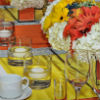 Fall-themed table decor with orange, white and yellow floral centrepieces and orange runners with jewel accents.