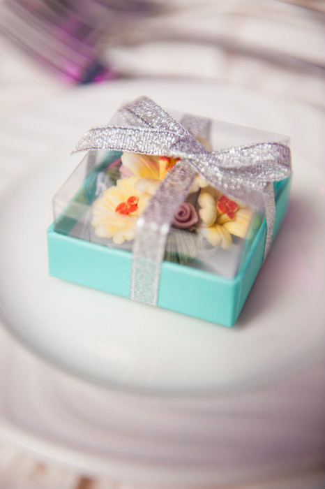 Chocolate flowers in a Tiffany-blue box with silver ribbon