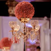 Gold candelabra with a rose ball bouquet and hanging crystal details
