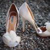 Badgely Mischka nude open peep-toed pumps with silk flowers