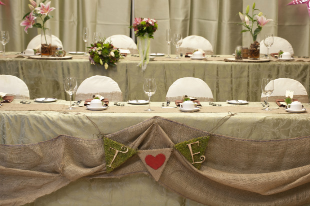 Head table with burlap swag and monogram embellishments