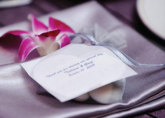 Thank you note on wedding favour with metallic lilac napkin