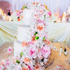 3 tier ivory cake with elaborate cascading flower detailing