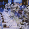 Rustic napkins with black and white favours and floral centrepieces