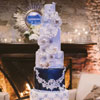 7 tier navy, white and silver winter-themed cake with various details