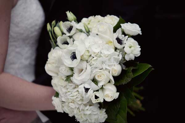 All White Bridal Bouquet With Roses Hydrangeas Tulips And Gerbera Daisies Black Centres