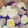 Vibrant bouquet with violet hydrangea, light purple roses and white peonies