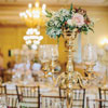 Gold candelabra with roses, rustic winter foilage and berries