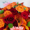 Bold fall bouquet with orange and red roses and coral gerbera daisy accents