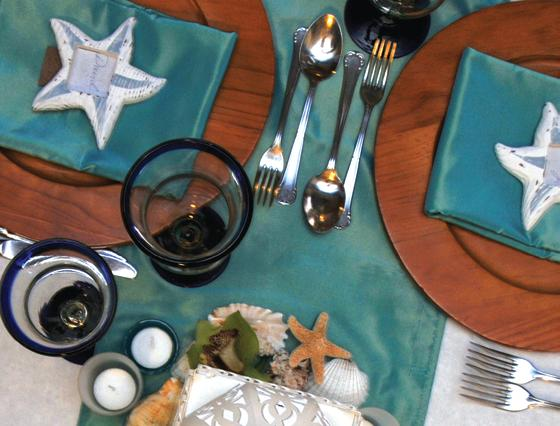 Island theme with teal & white table linens & place settings