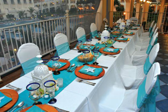 Island theme teal & white table linens, & unique white centerpieces