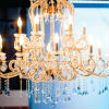 Gold chandelier adds classic elegance to reception décor