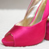 Hot pink satin peep-toed pumps with back bow detail